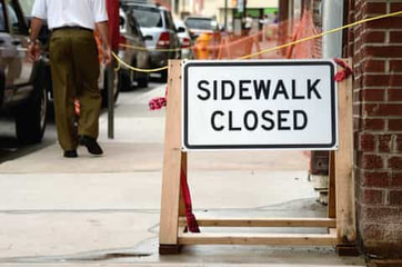 This is a picture of a damage nyc sidewalk with a sign sidewalk closed. Picture was taken in Park Slope Brooklyn, NY